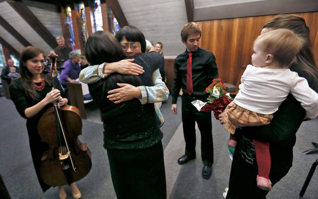Hiromi Hood hugs her daughter Rika Renee Hood Burr during the Hood Family Recital.  Photo by Chris Landsberger, The Oklahoman <strong>CHRIS LANDSBERGER - CHRIS LANDSBERGER</strong>