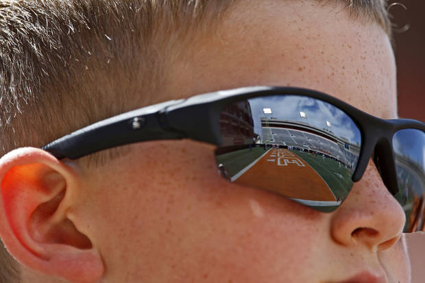 Colton Branch, 12, of Shawnee watches during the OSU spring football game at Boone Pickens Stadium in Stillwater, Okla., Sat., April 20, 2013. Photo by Bryan Terry, The Oklahoman