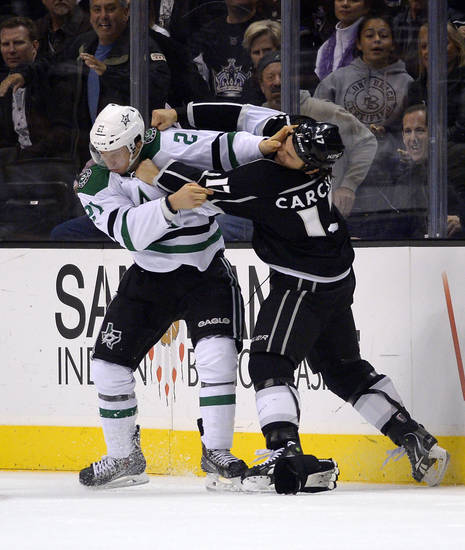 Dallas Stars left wing Antoine Roussel, left, of France, and Los Angeles Kings left wing Daniel Carcillo fight during the first period of their NHL hockey game, Saturday, Oct. 19, 2013, in Los Angeles.  (AP Photo/Mark J. Terrill)