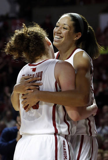 Oklahoma's Joanna McFarland (53) and Nicole Griffin (4) celebrate in the second half of the women's Bedlam basketball game between Oklahoma State University and Oklahoma at the Lloyd Noble Center in Norman, Okla., Sunday, Feb. 10, 2013.Photo by Sarah Phipps, The Oklahoman