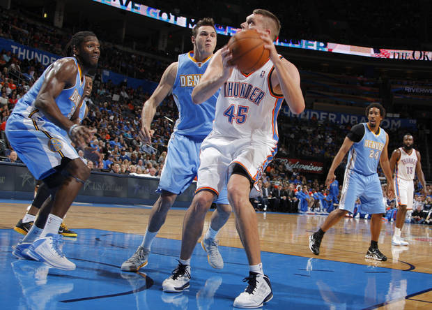 Oklahoma City&#039;s Cole Aldrich (45) looks for a shot during the NBA preseason basketball game between the Oklahoma City Thunder and the Denver Nuggets at the Chesapeake Energy Arena, Sunday, Oct. 21, 2012. Photo by Garett Fisbeck, The Oklahoman