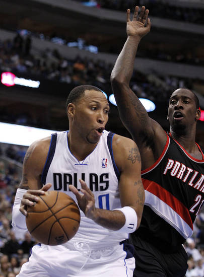 Dallas Mavericks' Shawn Marion (0) comes down with a defensive rebound in front of Portland Trail Blazers center J.J. Hickson (21) during the first half of an NBA basketball game, Monday, Nov. 5, 2012, in Dallas. (AP Photo/Tony Gutierrez)