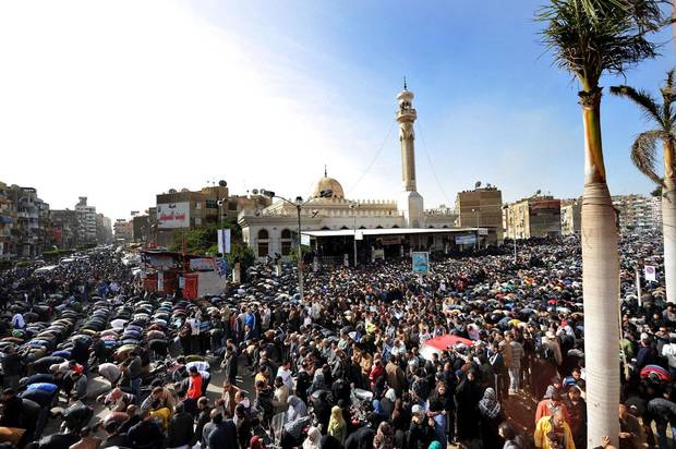 Egyptians pray during a mass funeral in Port Said, Egypt, Sunday, Jan. 27, 2013. Tens of thousands of mourners poured into the streets of the restive Egyptian city of Port Said on Sunday for a funeral for most of the 37 people killed in rioting a day earlier, chanting slogans against Islamist President Mohammed Morsi. (AP Photo)
