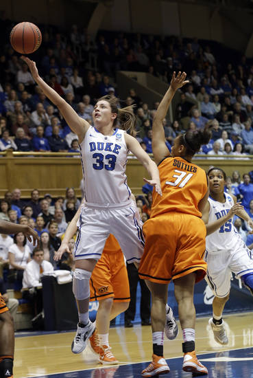 Duke's Haley Peters (33) drives to the basket against Oklahoma State's Kendra Suttles (31) during the first half of a second-round game in the women's NCAA college basketball tournament in Durham, N.C., Tuesday, March 26, 2013. Duke won 68-59. (AP Photo/Gerry Broome)