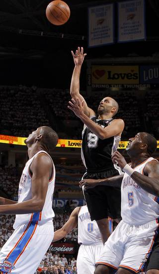 San Antonio's Tony Parker (9) puts up a shoot between Oklahoma City's Kevin Durant (35) and Kendrick Perkins (5) during Game 6 of the Western Conference Finals between the Oklahoma City Thunder and the San Antonio Spurs in the NBA playoffs at the Chesapeake Energy Arena in Oklahoma City, Wednesday, June 6, 2012. Photo by Bryan Terry, The Oklahoman