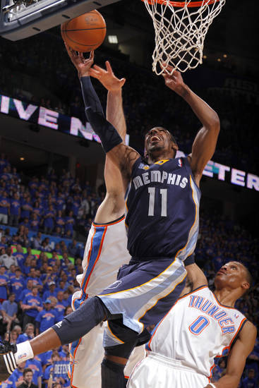 Mike Conley (11) of Memphis shoots a lay up as Oklahoma City's Nick Collison (4) and Oklahoma City's Russell Westbrook (0) defend during game 7 of the NBA basketball Western Conference semifinals between the Memphis Grizzlies and the Oklahoma City Thunder at the OKC Arena in Oklahoma City, Sunday, May 15, 2011. Photo by Sarah Phipps, The Oklahoman