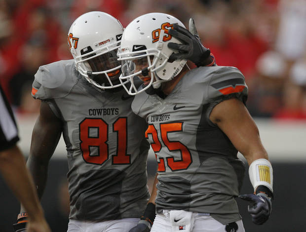 Oklahoma State's Justin Blackmon, left, and Josh Cooper celebrates a touchdown catch by Cooper. Photo by Sarah Phipps, The Oklahoman