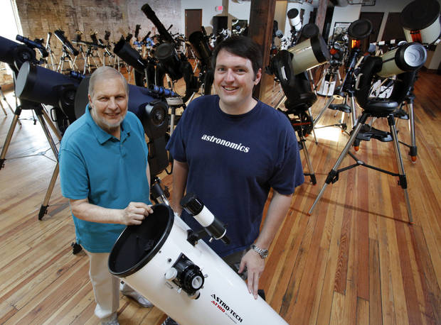 Fred Bieler (left) and son Mike, owners of Astronomics, stand in their second floor showroom on Tuesday, July 17, 2012 in Norman, Okla. The telescope specialty store recently moved to Main Street downtown giving it more showroom and retail space.  Photo by Steve Sisney, The Oklahoman