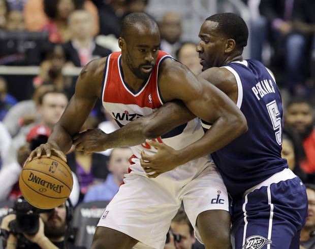 Washington Wizards center Emeka Okafor works against Oklahoma City Thunder center Kendrick Perkins in the first half of an NBA basketball game Monday, Jan. 7, 2013, in Washington. (AP Photo/Alex Brandon) ORG XMIT: VZN105