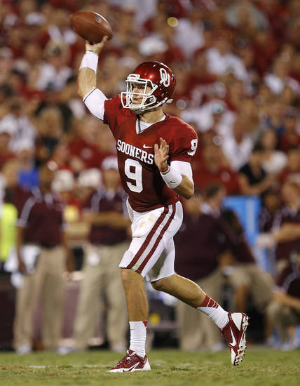 Oklahoma's Trevor Knight (9) throws a touchdown pass during a college football game between the University of Oklahoma Sooners (OU) and the University of Louisiana Monroe Warhawks at Gaylord Family-Oklahoma Memorial Stadium in Norman, Okla., on Saturday, Aug. 31, 2013. Oklahoma won 34-0. Photo by Bryan Terry The Oklahoman