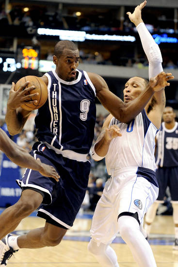 Oklahoma City Thunder forward Serge Ibaka (9) drives on Dallas Mavericks forward Shawn Marion (0) in the first quarter during an NBA basketball game, Friday, Jan. 18, 2013, in Dallas. (AP Photo/Matt Strasen)