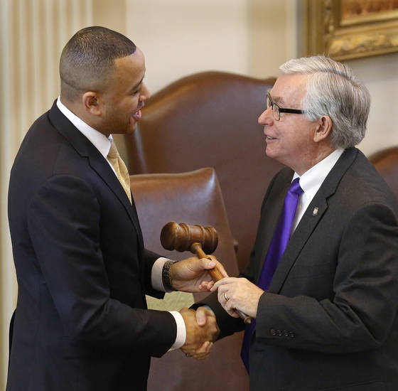 T. W. Shannon accepts the Speaker's gavel from Rep. Weldon Watson, majority caucus chairman, after being   elected by his colleagues in the Oklahoma House of Representatives as their Speaker for the upcoming legislative session. Shannon, a Republican from Lawton, is Oklahoma's first black Speaker of the House. He was sworn in on the floor of the House by Oklahoma Supreme Court Chief Justice Tom Colbert on Tuesday, Jan. 8, 2013.  Colbert became  Oklahoma's first black chief justice when he was sworn in last week.    Photo by Jim Beckel, The Oklahoman