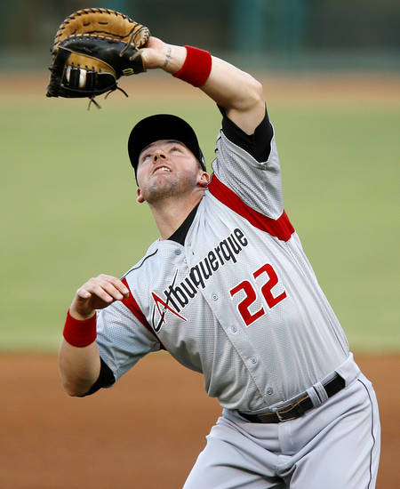 Josh Fields of the Albuquerque Isotopes catches the ball for an out against the Oklahoma City RedHawks at Chickasaw Bricktown Ballpark in Oklahoma City, Wednesday, August 29, 2012. Photo by Bryan Terry, The Oklahoman