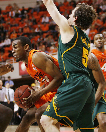 OSU's Markel Brown (22) tries to get the ball past Brady Heslip (5) of Baylor in the second half of a men's college basketball game between the Oklahoma State University Cowboys and the Baylor University Bears at Gallagher-Iba Arena in Stillwater, Okla., Saturday, Feb. 4, 2012. Baylor beat OSU, 64-60. Photo by Nate Billings, The Oklahoman