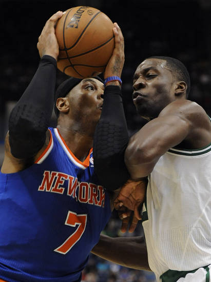 New York Knicks' Carmelo Anthony (7), left, is guarded by Boston Celtics' Jeff Green in the first half of an NBA preseason basketball game Saturday, Oct. 13, 2012, in Hartford, Conn. (AP Photo/Jessica Hill)