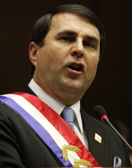Paraguay's new President Federico Franco addresses Congress after being sworn-in in Asuncion, Paraguay, Friday, June 22, 2012. Franco was promptly sworn in as president after Paraguay's Senate voted to remove President Fernando Lugo from office in an impeachment trial. (AP Photo/Cesar Olmedo)
