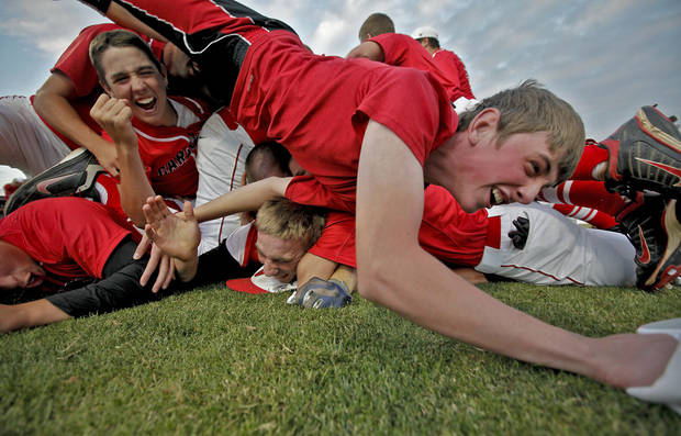 Verdigris' Nathan Green fall over the dog pile as the team celebrates after the 6-5 win over Metro Christian during the 3A State Championship baseball game at Edmond Memorial High School on Saturday,  May 12, 2012, in Edmond, Oklahoma. Photo by Chris Landsberger, The Oklahoman