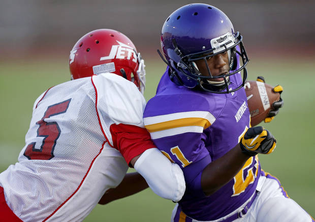 Northwest Classen's Lorenzo Alexander scores a touchdown past Western Heights' Davonte Drennan during a high school football game at Taft Stadium in Oklahoma City, Thursday, September 20, 2012. Photo by Bryan Terry, The Oklahoman