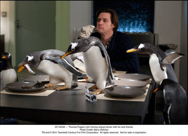DF-04246 — Thomas Popper (Jim Carrey) enjoys dinner with his new friends