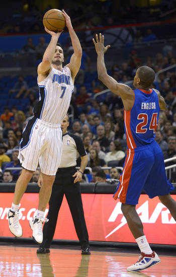 Orlando Magic guard J.J. Redick (7) puts up a 3-pointer in front of Detroit Pistons guard Kim English (24) during the first half of an NBA basketball game in Orlando, Fla., Sunday, Jan. 27, 2013. (AP Photo/Phelan M. Ebenhack)