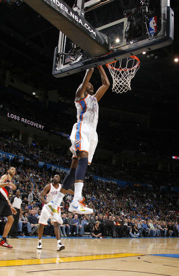 Oklahoma City's Kevin Durant (35) dunks during the NBA game between the Oklahoma City Thunder and the Portland Trailblazers, Sunday, March 27, 2011, at the Oklahoma City Arena. Photo by Sarah Phipps, The Oklahoman