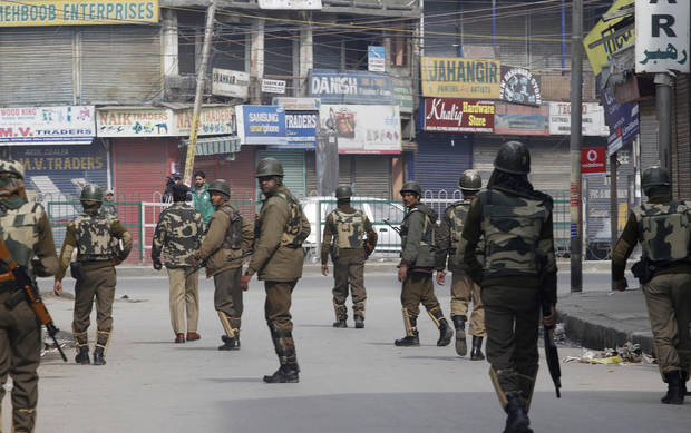 Indian paramilitary soldiers patrol on the fourth consecutive day of curfew imposed after the execution of a Kashmiri man convicted in a deadly 2001 attack on India's Parliament in Srinagar, India, Tuesday, Feb. 12, 2013. Mohammed Afzal Guru was hanged in New Delhi early Saturday. Ahead of the execution, authorities had anticipated anti-India protests and ordered people in most of the Indian-held part of the disputed Kashmir region to remain indoors indefinitely. (AP Photo/Mukhtar khan)