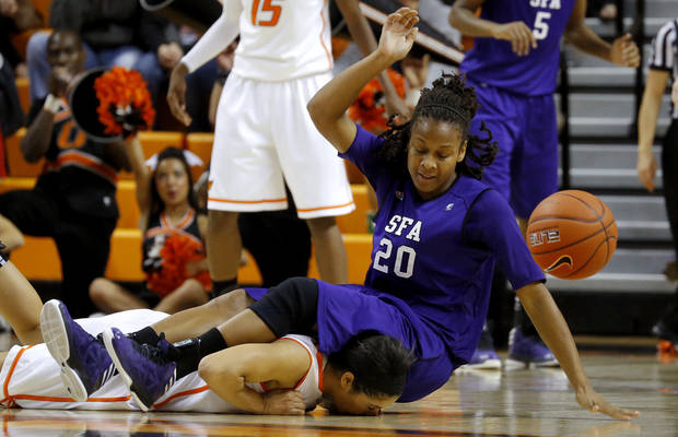 Stephen F. Austin's Antionette Carter (20) lands on top of Oklahoma State's Brittney Martin (22) during a women's college basketball game between Oklahoma State University and Stephen F. Austin at Gallagher-Iba Arena in Stillwater, Okla., Thursday, Dec. 6, 2012.  Photo by Bryan Terry, The Oklahoman