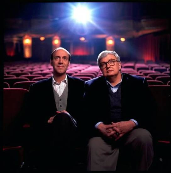 "This undated file photo originally released by Disney-ABC Domestic Television, shows movie critics Roger Ebert, right, and Gene Siskel. The Chicago Sun-Times is reporting that its film critic Roger Ebert died on Thursday, April 4, 2013. He was 70. Ebert and Siskel, who died in 1999, trademarked the ""two thumbs up"" phrase. (AP)"