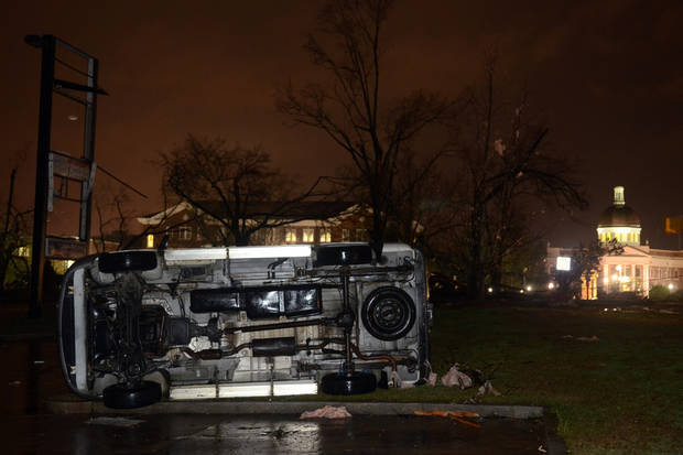 An overturned car lies in front of the University of Southern Mississippi campus in Hattiesburg, Miss., after a possible tornado Sunday, Feb. 10, 2013. (AP Photo/Chuck Cook) ORG XMIT: MSCC101