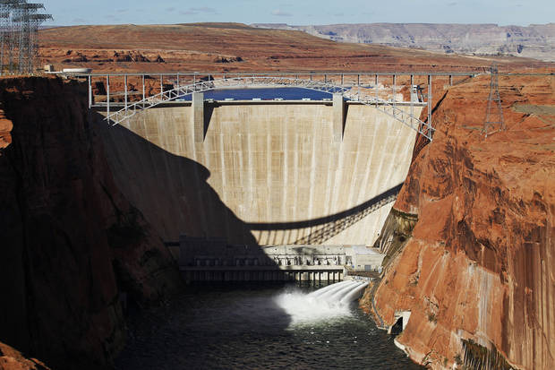 The high-flow release of water into the Colorado River from bypass tubes at Glen Canyon Dam in Page, Ariz., Monday Nov. 19, 2012 begins as Interior Secretary Ken Salazar opens the valves. Federal water managers started a 5-day high-flow experimental release to help restore the Grand Canyon's ecosystem. (AP Photo/The Arizona Republic,Rob Schumacher) MARICOPA COUNTY OUT; MAGS OUT; NO SALES