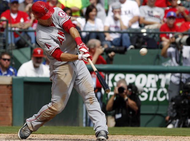 Los Angeles Angels' Mike Trout hits a solo home run against the Texas Rangers during the seventh inning of the first baseball game of a doubleheader, Sunday, Sept. 30, 2012, in Arlington, Texas. The Angels won 5-4. (AP Photo/LM Otero)
