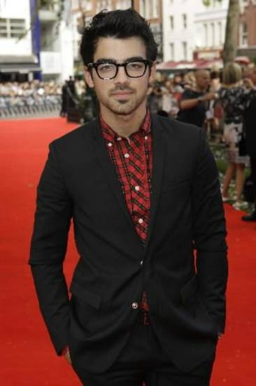 Joe Jonas arrives on the red carpet for the British premiere of The Twilight Saga: Eclipse, in London, Thursday, July 1, 2010.