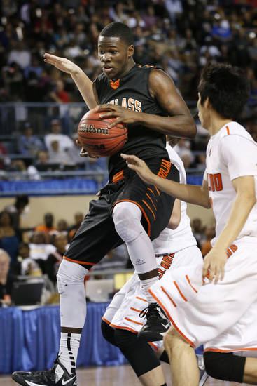 Douglass Glenn Banks comes up with a rebound during the 4a boys championship game where the Douglass high school Trojans play the Roland Rangers at the State Fair Arena on Saturday, March 9, 2013 in Oklahoma City, Okla.  Photo by Steve Sisney, The Oklahoman