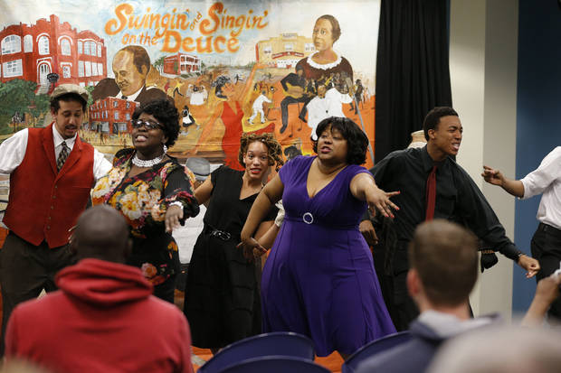Cast members perform in �Swingin� and Singin� in Deep Deuce� with Rhythmically Speaking at Belle Isle Library. PhotoS by Bryan Terry, The Oklahoman