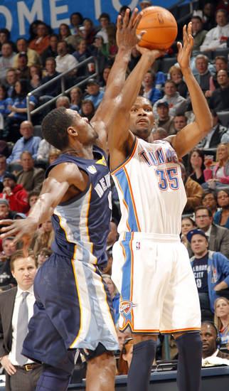 The Thunder's Kevin Durant (35) puts up a shot over Memphis' Tony Allen (9) during the NBA basketball game between the Oklahoma City Thunder and the Memphis Grizzlies at the Oklahoma City Arena on Tuesday, Feb. 8, 2011, Oklahoma City, Okla.