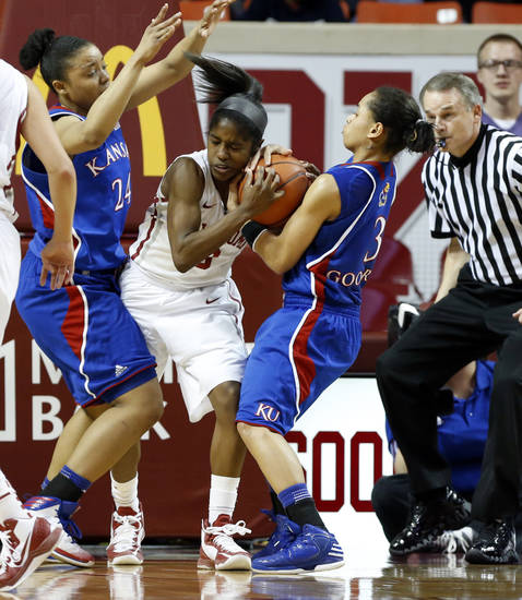 Kansas Jayhawks' CeCe Harper (24) and Angel Goodrich (3) try to take the ball from Oklahoma Sooner's Aaryn Ellenberg (3) in the second half as the University of Oklahoma Sooners (OU) defeat the Kansas Jayhawks 85-77 in NCAA, women's college basketball at The Lloyd Noble Center on Saturday, March 2, 2013  in Norman, Okla. Photo by Steve Sisney, The Oklahoman