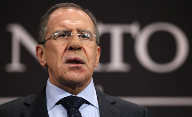 FILE- Russia's Foreign Minister Sergey Lavrov speaks at a media conference at NATO headquarters in Brussels, Belgium, in this file photo dated Tuesday, Dec. 4, 2012.  Lavrov said Saturday Dec. 22, 2012, that the Syrian government has consolidated its chemical weapons to safeguard the arsenal at one or two locations, and also revealed that Russia has military advisers in the country and have kept close watch over its chemical weapons. (AP Photo/Yves Logghe, File)