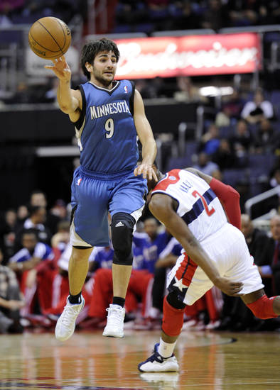 Minnesota Timberwolves guard Ricky Rubio (9), of Spain, passes off the ball against Washington Wizards guard John Wall (2) during the first half of an NBA basketball game on Friday, Jan. 25, 2013, in Washington. (AP Photo/Nick Wass)