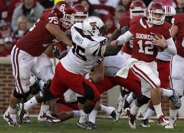 Oklahoma's Landry Jones (12) runs the ball out of the pocket during the second half of the college football game between the University of Oklahoma Sooners (OU) and the Texas Tech Red Raiders (TTU) at the Gaylord Family-Oklahoma Memorial Stadium on Saturday, Nov. 13, 2010, in Norman, Okla.  Photo by Chris Landsberger, The Oklahoman