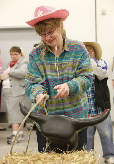 Heather Wester tries roping a practice steer.
