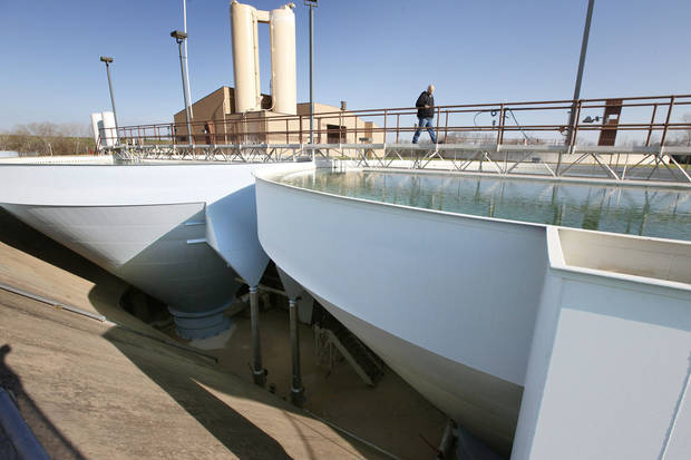 Chief plant operator Scott Horner walks above contact clarifiers Friday at Edmond�s water treatment plant. The plant treats water from Arcadia Lake before it�s pumped to customers in Edmond. PHOTO BY PAUL HELLSTERN, THE OKLAHOMAN