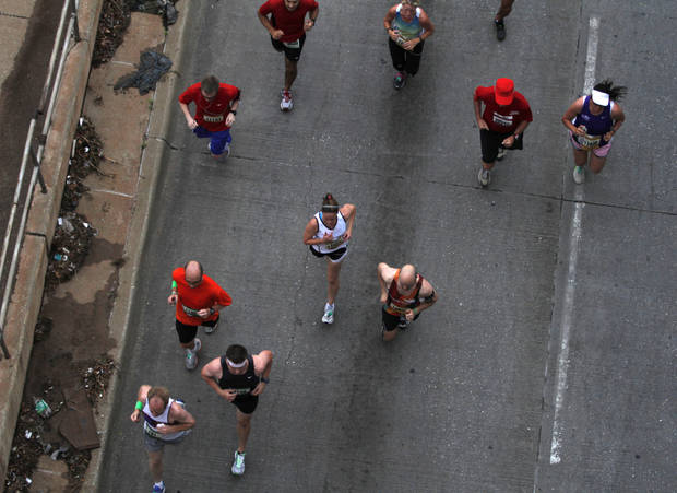 Participants run down 23rd Street during the twelfth annual Oklahoma City Memorial Marathon in Oklahoma City, Sunday, April 29, 2012.  Photo by Garett Fisbeck, For The Oklahoman