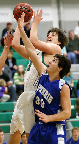 David Love (41) of Bishop McGuinness takes a shot against Bailey Nichols (33) of Guthrie during a game between Guthrie and Bishop McGuinness in the McGuinness Classic boys high school basketball tournament at Bishop McGuinness Catholic High School in Oklahoma City, Friday, Jan. 11, 2013. Photo by Nate Billings, The Oklahoman