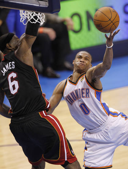 NBA BASKETBALL: Oklahoma City's Russell Westbrook (0) shoots past Miami's LeBron James (6) during Game 2 of the NBA Finals between the Oklahoma City Thunder and the Miami Heat at Chesapeake Energy Arena in Oklahoma City, Thursday, June 14, 2012. Photo by Chris Landsberger, The Oklahoman
