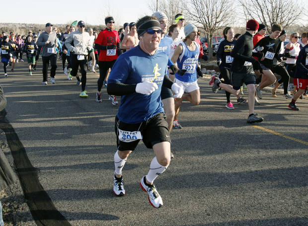 Runners begin their race as Edmond North High School holds their Balto 5K run and walk at Mitch Park in Edmond, OK, Saturday, Jan. 28, 2012. By Paul Hellstern, The Oklahoman