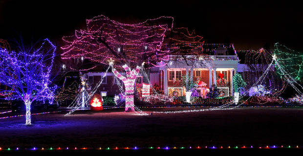 An eye-catching, car-stopping lighting display illuminates yards of three neighboring house on Grand Boulevard in Nichols Hills .  December 18, 2011.   Photo by Jim Beckel, The Oklahoman