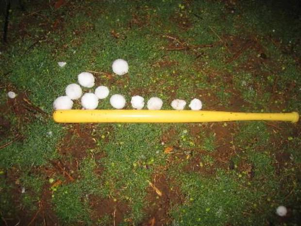 File photo - Hail stones the size of baseballs in Rocky, Okla. next to a wiffle bat Sunday, March 29, 2008.  Photo by Ron Jackson