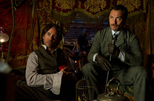 "In this image released by Warner Bros. Pictures, Robert Downey Jr., left, and Jude Law, are shown in a scene from ""Sherlock Holmes: A Game of Shadows."" (AP Photo/Warner Bros. Pictures, Christopher Raphael) ORG XMIT: NYET217"