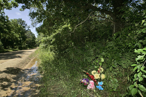 A memorial to Taylor Paschal-Placker and Skyla Whitaker is pictured in Weleetka, Okla., Tuesday, June 10, 2008, at the spot along a rural road near Taylor's home where the girls' bodies were found Sunday night. (AP Photo)