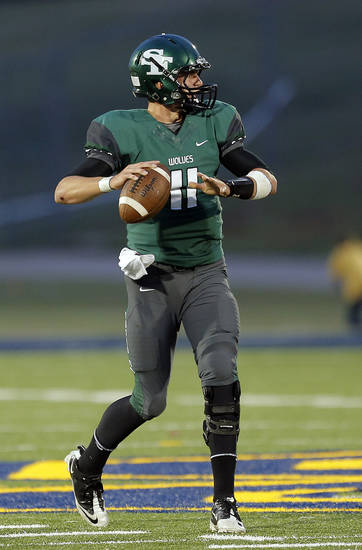 Edmond Santa Fe's Justice Hansen looks to throw the ball during high school football game between Edmond Santa Fe and Edmond North at Wantland Stadium in Edmond, Okla.,  Friday, Sept. 14, 2012. Photo by Sarah Phipps, The Oklahoman